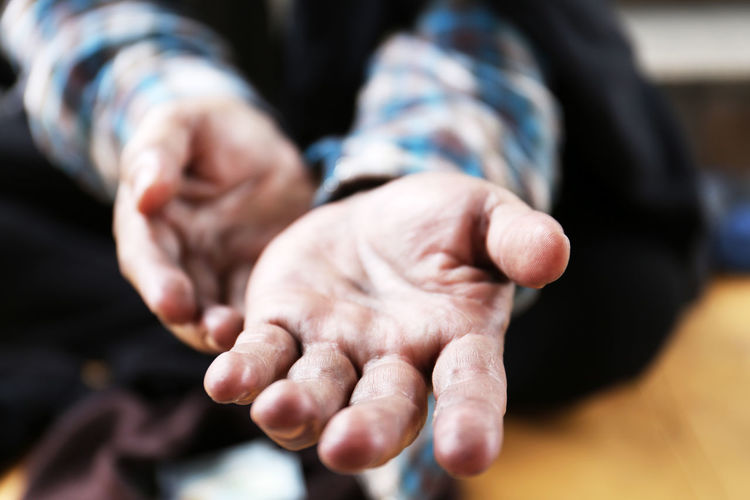 Cropped image of homeless man gesturing