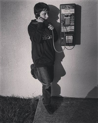 Taught my son to use a payphone! How many faces do you see??? Kinda spooky on this of all nights! Spooky Payphone FirstTime Hello Faces Shadows Blackandwhitephotography Blackandwhite Pennsylvania