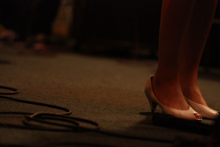 closeup of musician's feet performing Close-up Closeup Cords Cropped Day Feet Floor Focus On Foreground Heels Legs Leisure Activity Lifestyles Low Section Moody Musician Part Of Person Selective Focus Shoes Singer  Skill  Style Unrecognizable Person Yellow Light