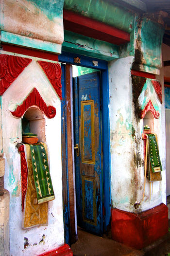 Architecture Architecture Bali Built Structure Close-up Colored Door Day Door Doorways Bali Human Representation Indoors  Male Likeness Multi Colored No People Oldest Village Bal Place Of Worship Religion Sculpture Spirituality Statue Traditional Indonesian Doorways