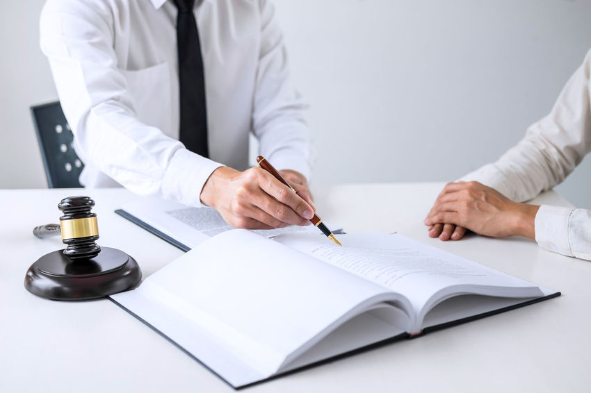 Lawyer Balance Barrister Business Consultant Counselor Customer  Document Fairness Formalwear Front View Gavel Hand Holding Human Hand Indoors  Judge Judgement Justice Men Occupation Paper Sitting Verdict Writing