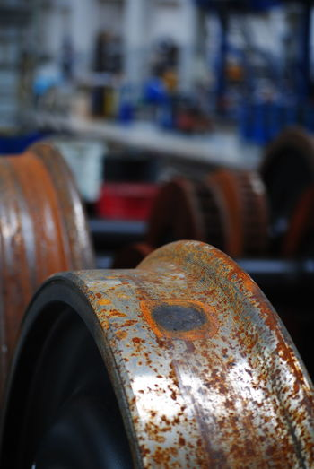 Rusty Trainwheel Focus On Foreground Close-up Indoors  Rusty Rusty Metal Steelwheels Axle Trainphotography