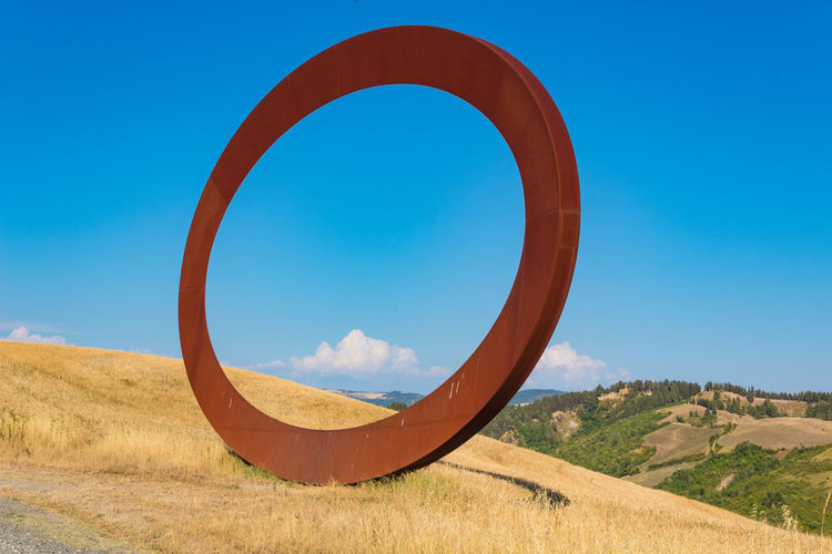 Tuscany Art Beauty In Nature Blue Circle Clear Sky Close-up Countryside Day Field Grass Landscape Mountain Nature No People Outdoors Scenics Sky Sunlight Tranquility Tree