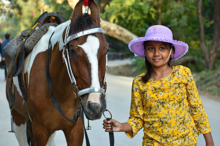 A teenage girl working with a horse