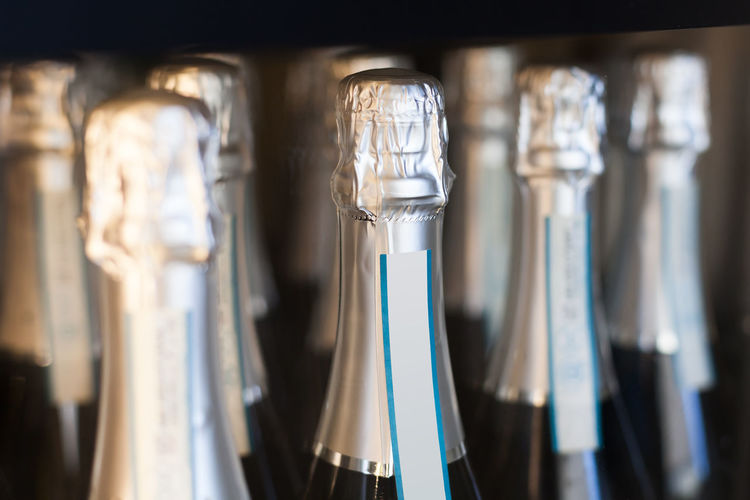 champagne bottles displayed Bubbles Celebration Champagne Liquid Sparkling Toast Alcohol Anniversary Bottles Celebtration Cheers Close-up Closed Detail Displayed Drink Glass Luxury Many No People Occasion Party Row Special Wine