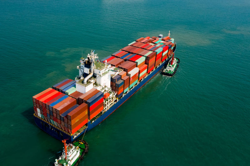 Logistics and transportation of international container cargo ship in the ocean freight aerial view