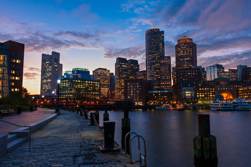 The Boston skyline at night. Building Exterior Architecture Built Structure City Building Sky Water Office Building Exterior Urban Skyline Illuminated Cityscape Skyscraper Cloud - Sky City Life Tall - High Dusk Nature Landscape River Modern No People Outdoors Financial District  Boston