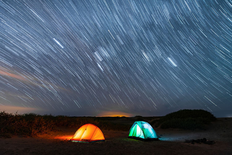 Camping Nightphotography Adventure Astronomy Beauty In Nature Camping Constellation Galaxy Illuminated Long Exposure Motion Nature Night No People Outdoors Scenics Sky Star - Space Star Trail Stars Tent Tent Camping Tranquil Scene