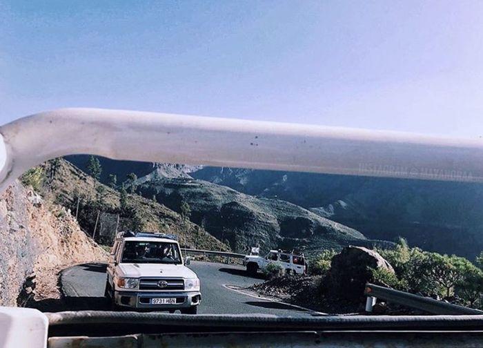 Car on bridge against sky