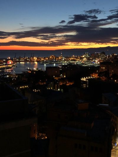 Dusk in Genoa Sky Water Illuminated Sunset No People City Architecture Night Nature Cloud - Sky Scenics - Nature Building Exterior Cityscape Built Structure Sea Beauty In Nature Outdoors Orange Color Dusk