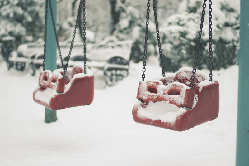 Close-up of swing during winter