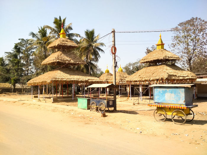Religious Place Odishatourism Odisha Art Indian Sand Day Outdoors Tree Sky Nature No People Palm Tree Transportation Shelter Thatched Roof