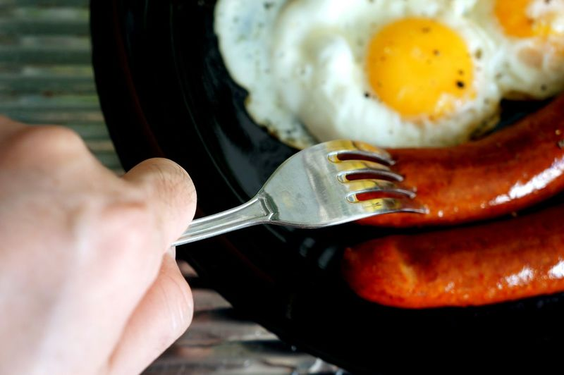 Cropped hand of person having breakfast