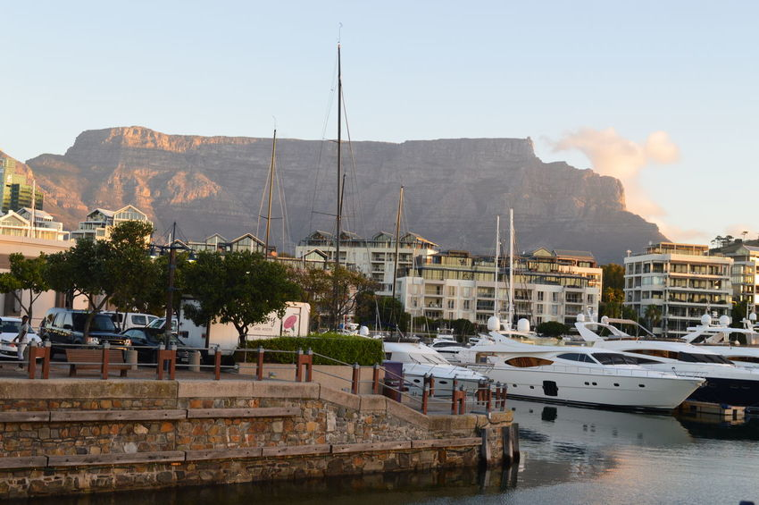 Architecture Boat Built Structure Cape Town City City Life Cityscape Day Harbor Mast Mode Of Transport Mountain Mountain Range Nature Nautical Vessel No People Outdoors Residential District Sailboat Sky Tabletop Mountain Town Travel Destinations Water