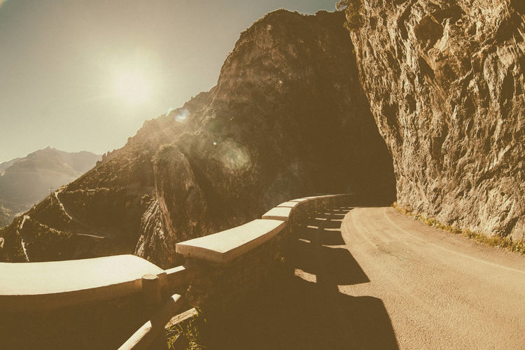 Curve Sunrays Beauty In Nature Cliff Curved Street Day Landscape Mountain Mountain Range Nature No People Outdoors Scenics Shadow Sky Street Sunlight Tranquil Scene Tranquility
