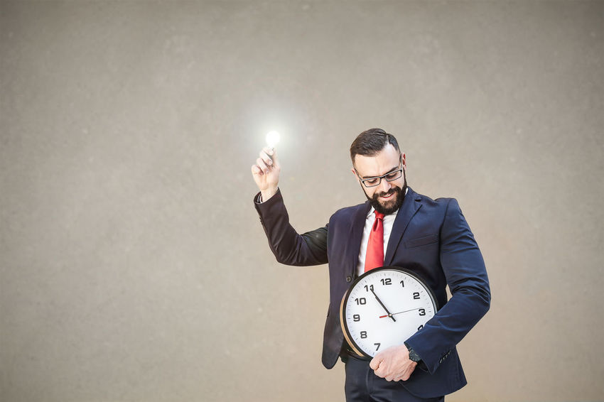 Model: Roberto Materiale Adult Business Business Person Businessman Clock Formalwear Front View Holding Indoors  Males  Men Menswear Mid Adult Men One Person Standing Studio Shot Suit Time Well-dressed