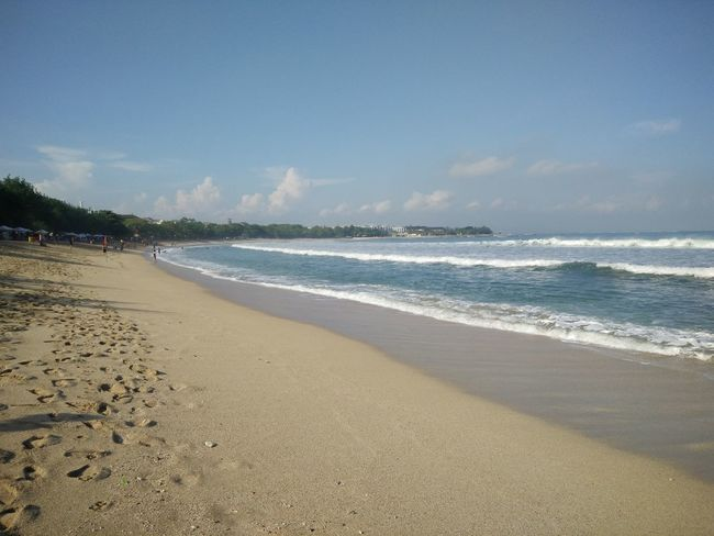 Wide view of Kuta Beach, Bali, Indonesia Beach Beauty In Nature Blue Calm Cloud Cloud - Sky Coastline Day Horizon Over Water Idyllic Nature No People Non-urban Scene Outdoors Remote Sand Scenics Sea Shore Sky Tranquil Scene Tranquility Vacations Water Wave