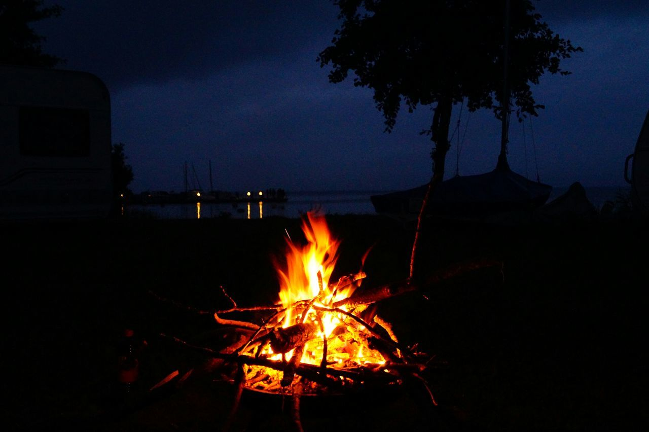 sky, night, nature, burning, fire, flame, fire - natural phenomenon, heat - temperature, tree, no people, bonfire, orange color, illuminated, silhouette, water, land, plant, glowing, outdoors, campfire
