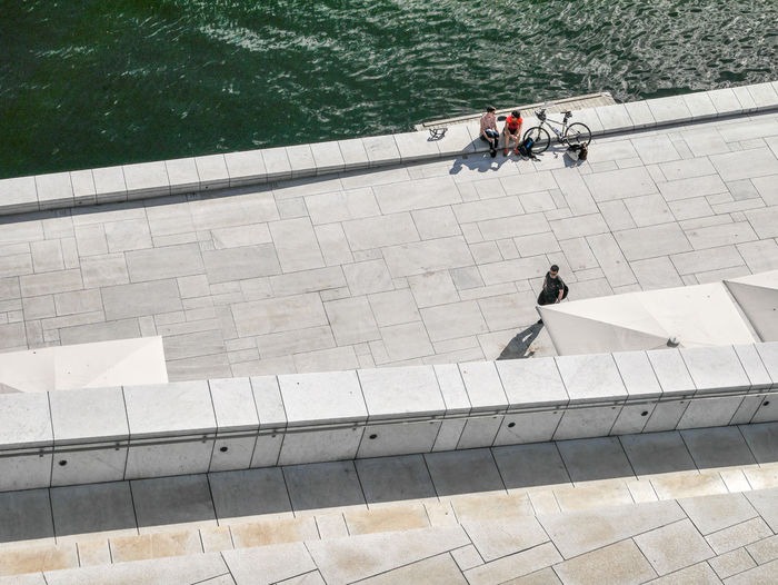 High angle view of people on swimming pool