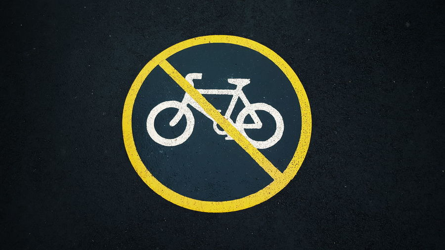 Close-up of no cycling sign on street