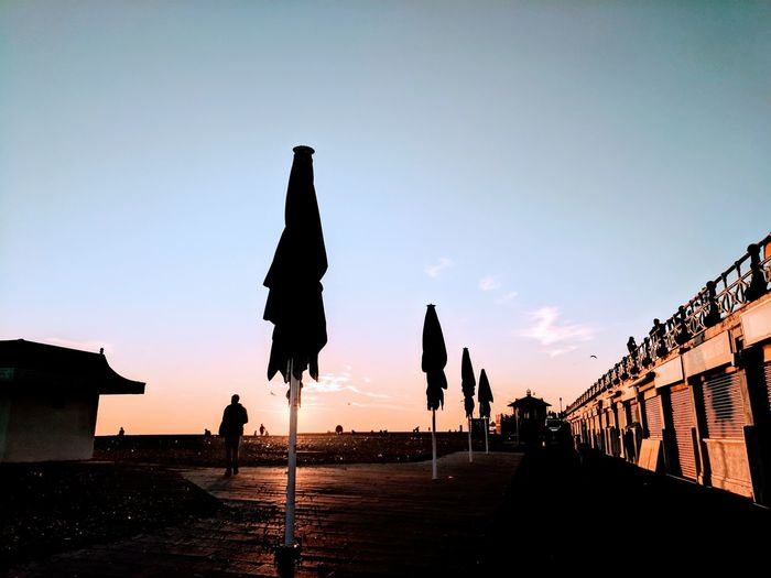Silhouette Sunset Sky Outdoors No People Nature Beauty In Nature Day Broadwalk Deck Beach Umbrella Golden Hour Reflection Tranquility Tranquil Scene Brighton Brighton Beach Brighton Seafront Leading Line Google Pixel