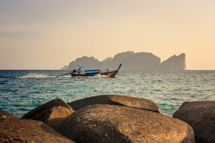 Phi Phi Leh at sunset, Phi Phi Island (Koh Phi Phi), Thailand. Colors Thai Thailand Tranquility Beauty In Nature Island Ko Phi Phi Leisure Activity Nature Phi Phi Island Rock Rock - Object Scenics - Nature Sea Sea And Sky Seascape Sky Solid Sunset Tranquil Scene Tranquility Travel Destinations Water