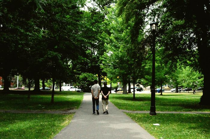 I dont know if they were a couple or just friends but they looked very happy Park Walking Around Couple Friends Enjoying Life Enjoying Each Others Company Peaceandlove Greenery Grass Treescollection Queens Park Toronto Showcase June People Together