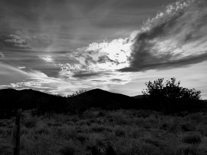 """Sky Over Little Cougar"" Late afternoon sun trying to break through the clouds over Little Cougar Mountain in Central New Mexico. Black And White Photography Black And White New Mexico Skies New Mexico Photography New Mexico Silhouettes Silhouette Clouds And Sky Clouds Sky Cloud - Sky Nature Beauty In Nature No People Tranquility Scenics Landscape Mountain Outdoors"