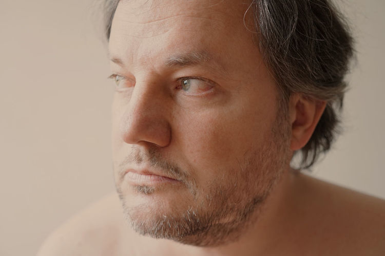 40s Adult Beard Close-up Gazing Into Distance Guy Headshot Indoors  Loneliness Looking Away Lost In Thought Man Melancholy Men Middle Aged One Person Pensive People Portrait Real People Sadness Serious Thinking