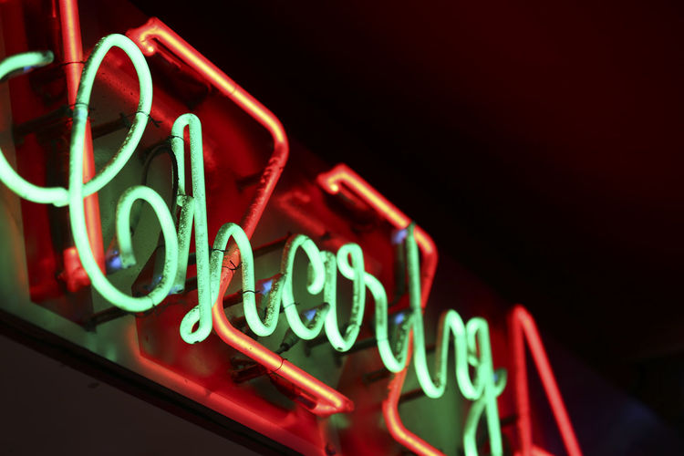 Text Western Script Illuminated Neon Communication No People Night Sign Lighting Equipment Red Glowing Close-up Green Color Light - Natural Phenomenon Multi Colored Capital Letter Indoors  Copy Space Low Angle View Commercial Sign Nightlife Capture Tomorrow