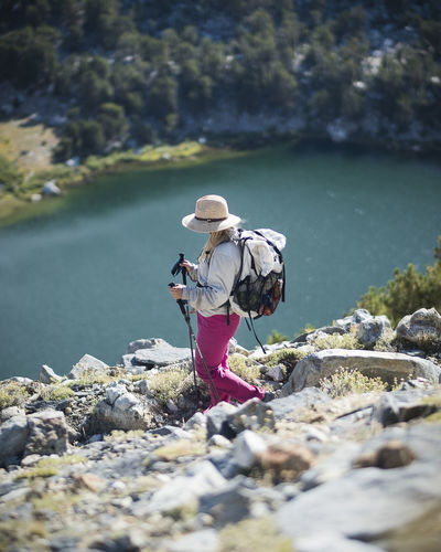Hiking in the Eastern Sierras. Solid Rock Water Rock - Object Real People Lifestyles One Person Leisure Activity Full Length Day Nature Hat Beauty In Nature Clothing Women Selective Focus Adult River Outdoors