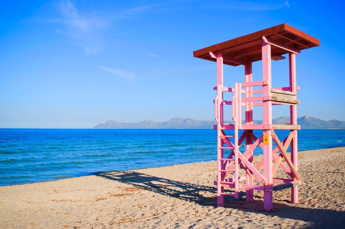 Mallorca Pink Sea Beach Water Sand Scenics Tranquil Scene Sky Horizon Over Water Beauty In Nature Travel Destinations Lifeguard Hut Lifeguard