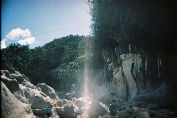 Daranak Daranak Falls Beauty In Nature Cave Daranakfalls Day Group Of People Land Leisure Activity Men Nature Outdoors People Plant Real People Rock Rock - Object Rock Formation Scenics - Nature Sky Solid Tree Water