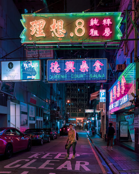 Yau Ma Tei Neon Lights One Person Neon Sign EyeEm Best Shots EyeEm Selects EyeEm Gallery City Street Architecture Building Exterior Car Motor Vehicle Built Structure Transportation City Life Illuminated Mode Of Transportation Real People Walking Men City Street Lifestyles People Road Sign Land Vehicle The Art Of Street Photography