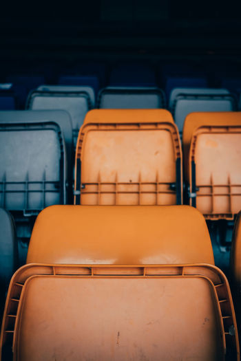 Empty chairs in stadium