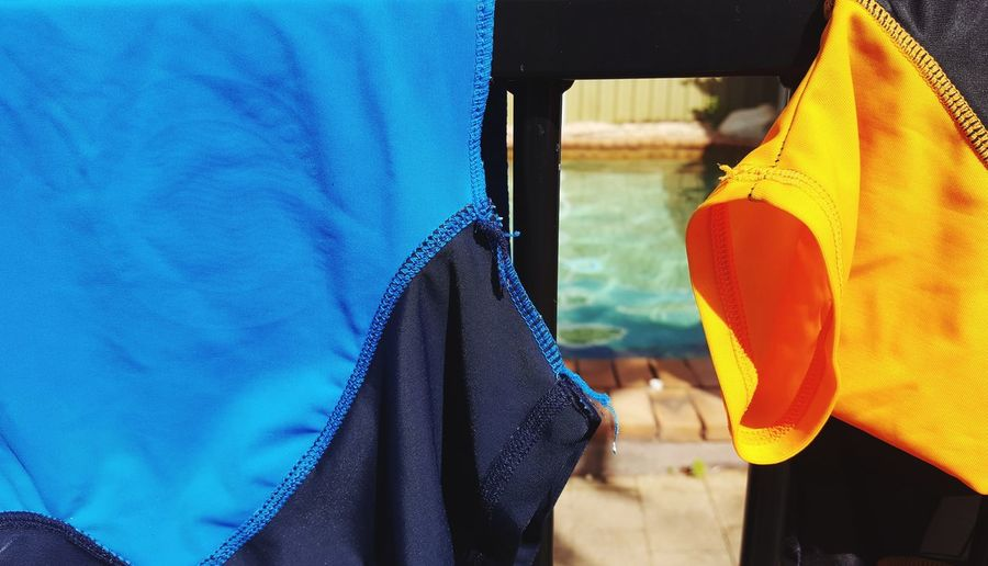Hanging Swimming Sun Sun Safety Child Clothing EyeEm Selects Textile Day People Blue Water Close-up