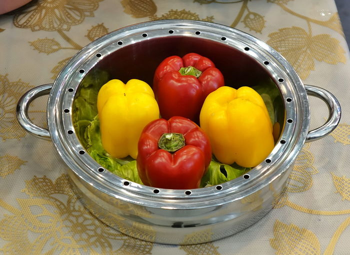 A team pot with red and yellow peppers Food Vegetable Healthy Eating Bell Pepper Vegetarian Food High Angle View Yellow Red Pepper Freshness Steam Pot Steamer Healthy Cooking Stainless Steel