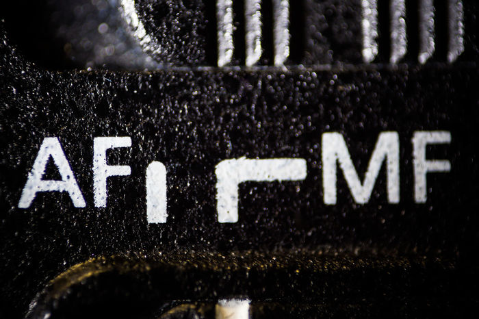 Auto Focus Backgrounds Black Color Close-up Focus On Foreground Full Frame Information Macro Macro Photography Manual Focus Mode No People Text Textured  White