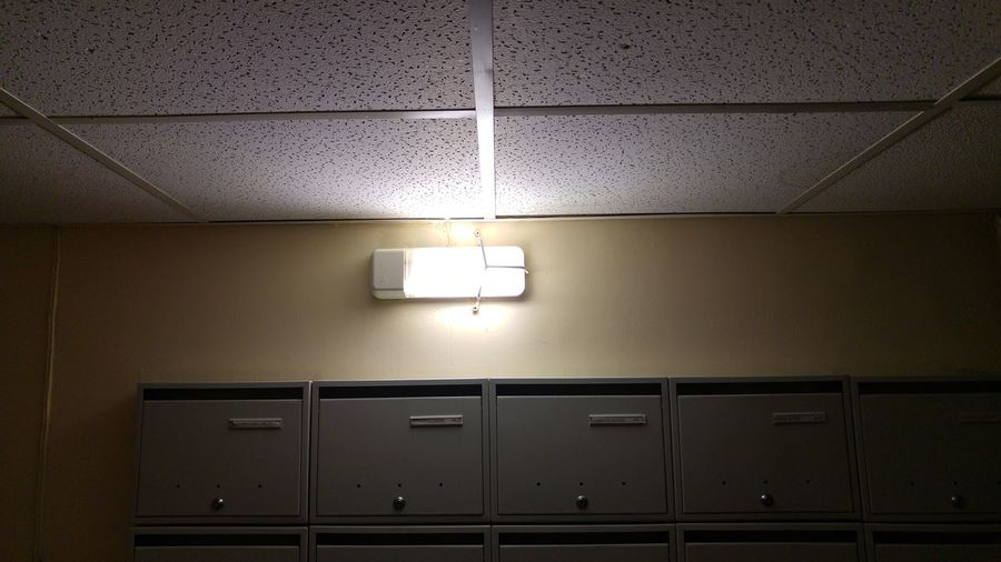Lights on mailboxes Architecture Ceiling Ceiling Design Ceiling Lights Day Illuminated Indoors  Letterbox Light And Shadow Lighting Equipment Mailbox No People Office Reception Shadow Shadows & Lights Wall