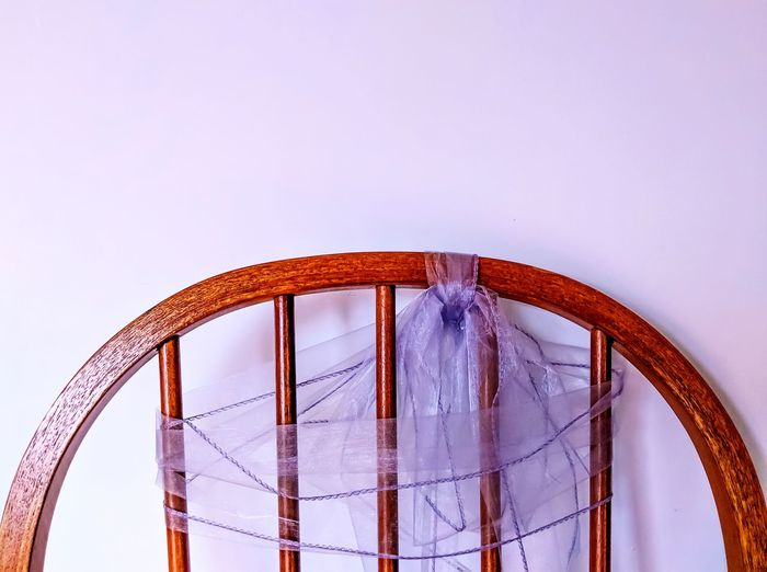 Top of Chair with Ribbon Against White Background, Illuminated from Left Decoration Close-up Illuminated Top Of Chair Straight Lines Wooden Chair White Background Chair Ribbon Interior Interior Design Furnitures Indoors  Lace Wood - Material Copy Space Wooden