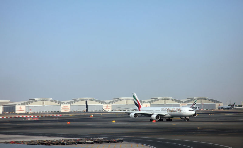 Emirates Airbus A340 at Dubai Airport on December 09, 2012 in Dubai, UAE. Emirates handles major part of passenger traffic and aircraft movements at the airport. Airbus Aircraft Airfield Airline Airliner Airplane Airport Aviation Boarding Boeing Carrier Commercial Docked Dubai Emirates Flight Jet Load Passenger Plane Platform Runway Terminal Traffic Transportation