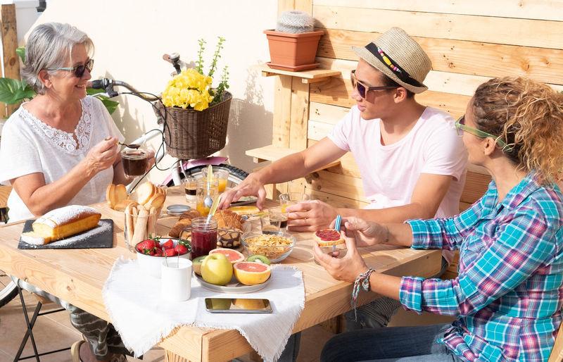People enjoying food on table