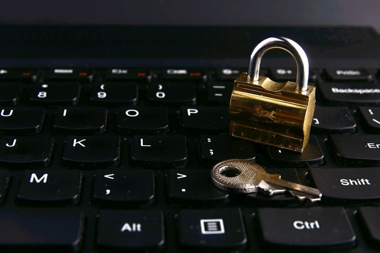 Close-Up Of Key And Padlock On Computer Keyboard