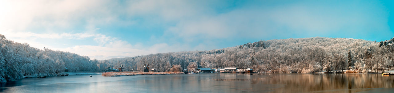 Winter panorama with windmills on a foggy winter day, sibiu, romania