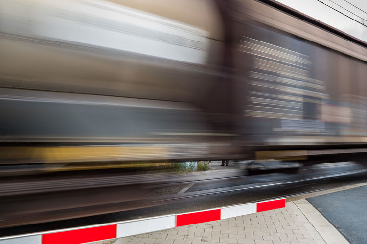 Blurred Motion Day Long Exposure Mode Of Transport Motion No People Outdoors Railroad Crossing Sign Speed Transportation