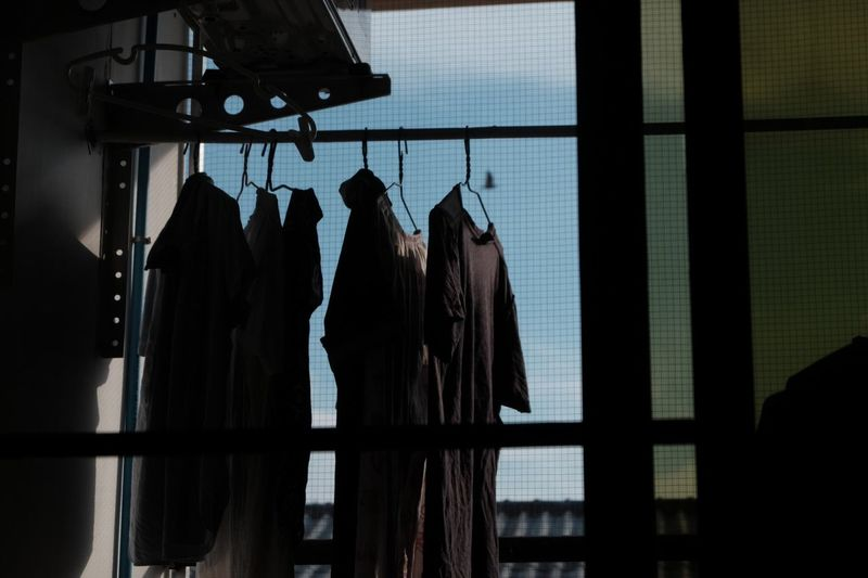 Laundry drying by window
