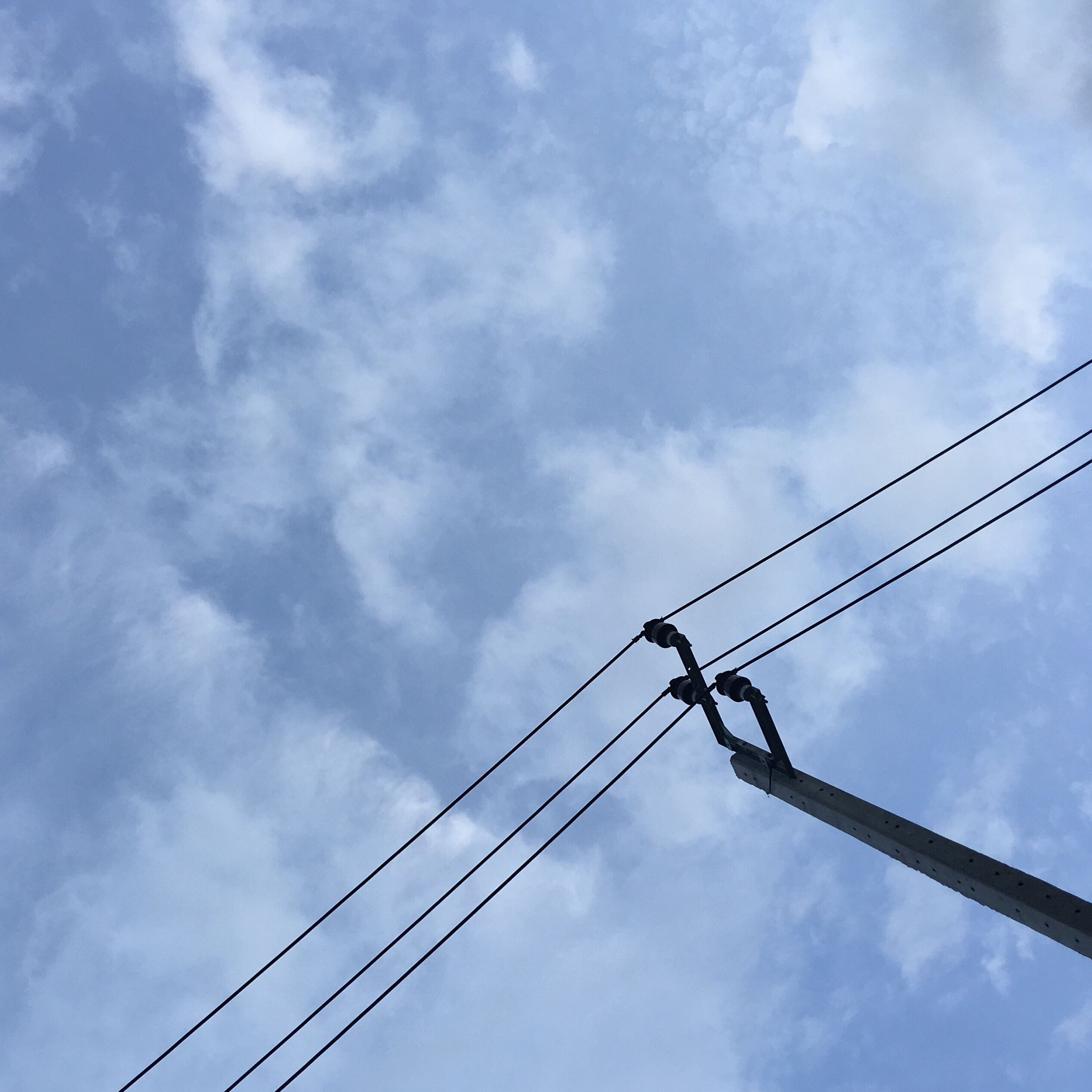 low angle view, connection, cable, power line, blue, sky, day, power supply, power cable, cloud, cloud - sky, nature, outdoors, long, tranquility, high section, no people, telephone line, cloudscape, cloudy, tranquil scene