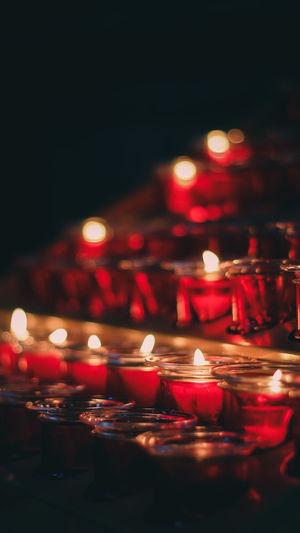 Illuminated tea light candles in temple