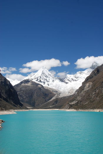 Mountain Scenics - Nature Beauty In Nature Water Sky Blue Tranquil Scene Tranquility Mountain Range Waterfront Day Idyllic Nature Cloud - Sky Snow Outdoors Mountain Peak Turquoise Colored Snowcapped Mountain No People