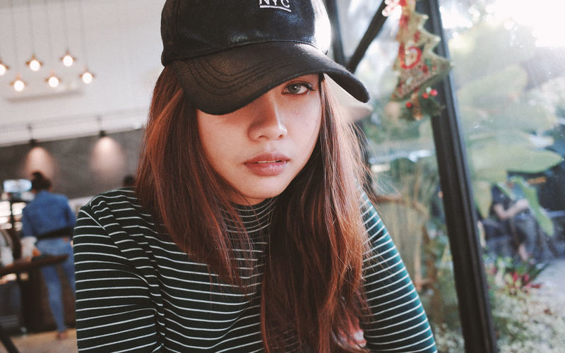 Portrait Young Adult One Person Young Women Real People Leisure Activity Headshot Looking At Camera Hat Long Hair Hairstyle Focus On Foreground Lifestyles Clothing Hair Front View Beauty Beautiful Woman Contemplation